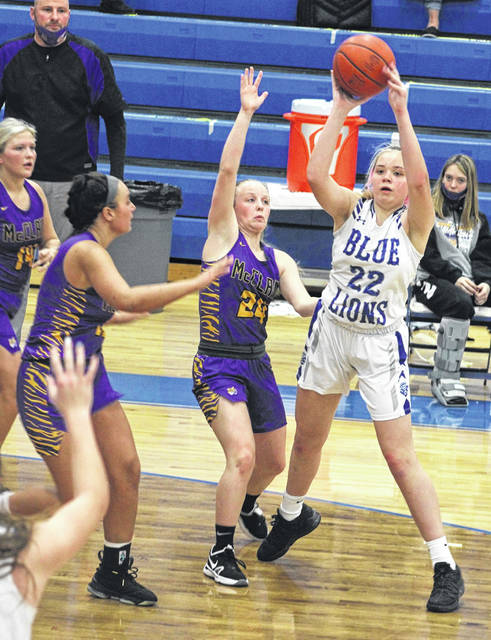 Washington freshman Calleigh Wead-Salmi (22) looks for a teammate while guarded by McClain senior Kyla Burchett (24), sophomore Payton Pryor and senior Jaelyn Pitzer (14) during a Frontier Athletic Conference game Saturday, Jan. 9, 2021 at Washington High School.