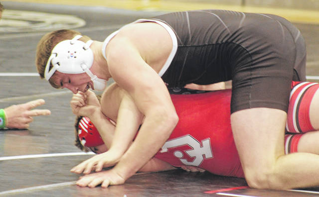Miami Trace senior Graham Carson is about to pin Mike Baker of Jackson in a 182-pound match at Miami Trace High School Thursday, Jan. 7, 2021.