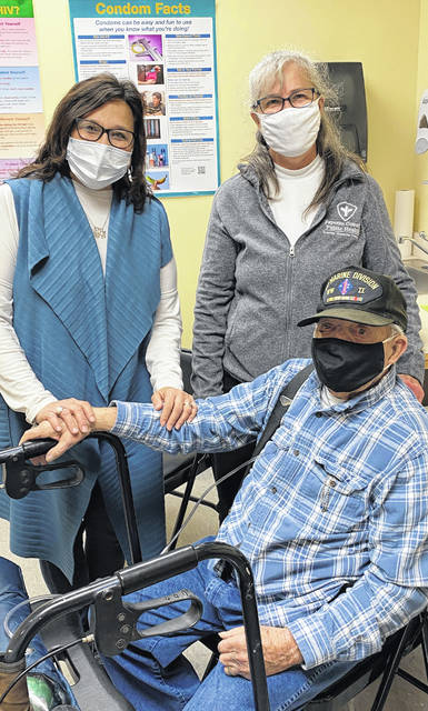World War II veteran Robert Estle, 96, of Washington Court House, received his first dose of the COVID-19 vaccine from Director of Nursing Tonda Bradley, RN, on Tuesday. Posing with 'Bob' and Tonda is his friend and FCPH clerk, Heidi Phipps.