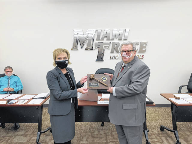 On Monday, Miami Trace Superintendent Kim Pittser presented board of education member Bruce Kirkpatrick, who served as board president in 2020, with a plaque of appreciation.