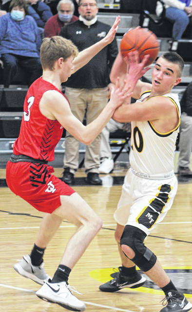 Miami Trace sophomore Isaiah Reisinger, right, is closely guarded by Jackson junior Nate Woodard during a Frontier Athletic Conference game at Miami Trace High School Friday, Jan. 8, 2021.