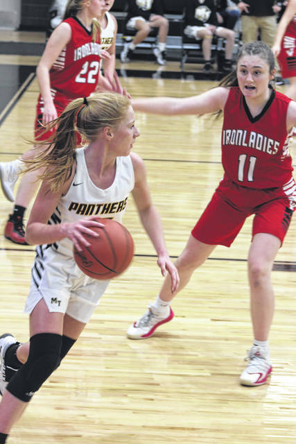 Senior Magarah Bloom, left, led Miami Trace in scoring with 18 points in a 45-36 win over Jackson Saturday, Jan. 9, 2021. At right for Jackson is freshman Teresa Carpenter.