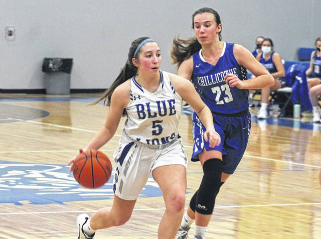 Washington sophomore Megan Sever drives around Chillicothe sophomore Avery Erslan during a Frontier Athletic Conference game at Washington High School Wednesday, Jan. 20, 2021.