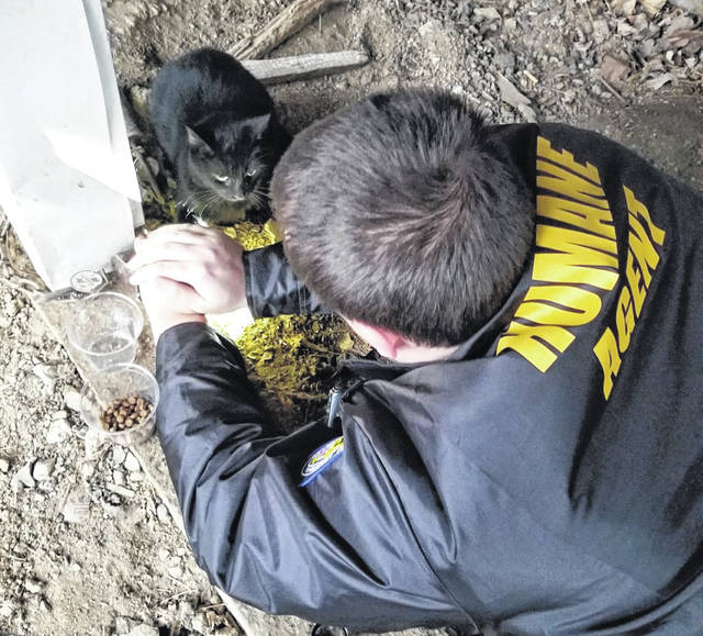 Fayette Regional Humane Society (FRHS) conducted a rescue on Tuesday in which a cat was stuck in a steel leg hold trap most likely meant for raccoons. The cat, Terri, survived and is now ready for adoption. Pictured with Terri is FRHS Deputy Humane Agent Johnny Daugherty.
