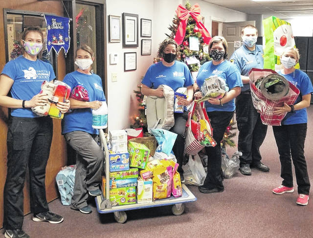 Several community members placed gifts under the Fayette Regional Humane Society Giving Tree during the holiday season. Pictured are (left-to-right) Animal Care Manager Haylee Riley, Animal Care Technician Tammy Vance, Adoption Coordinator Bobbi Honicker, Veterinary Technician Danyel Bageant, Deputy Humane Agent Johnny Daugherty and Receptionist Amber Delaney.