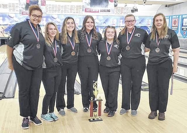 The Miami Trace girls varsity bowling team participated in the Muskingum University Bowling Invitational in Wilmington at Royal Z Lanes on Monday, Jan. 18, 2021. The team placed third and were awarded individual medals and a trophy for the school. (l-r); Onesti Evans, Lindsey Stump, Brianna Gozy, Gabby McCord, Macie Caudill, Ashtin Ruth, and head coach Diane Amore.