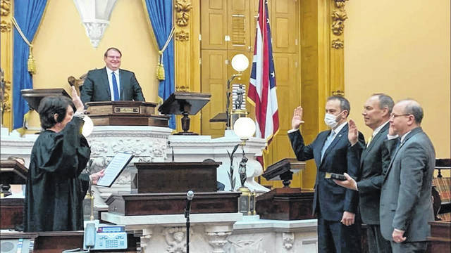 State Senator Bob Peterson (middle on the right) takes the oath of office for the 134th General Assembly.