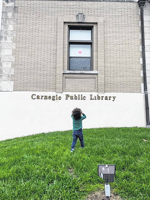 Although the Carnegie Public Library building was closed to the public in May of 2020 due to the pandemic, Caden was excited to find pictures in the library windows. Caden, son of Carly and Wade Park, was and is a regular attendee at the library's storytimes.