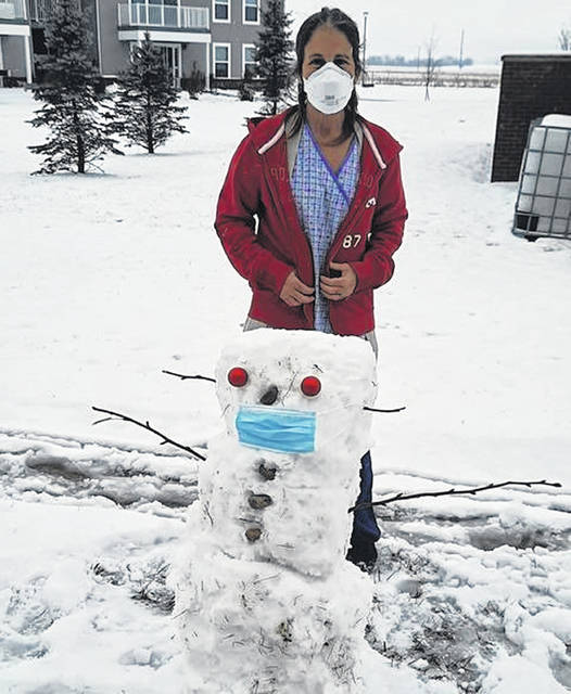Over the weekend, Four Seasons of Washington Dietary/Housekeeping supervisor Sherry Knuckles took advantage of the snowy weather by making a snowman for the facility's memory residents to see and enjoy from their window.