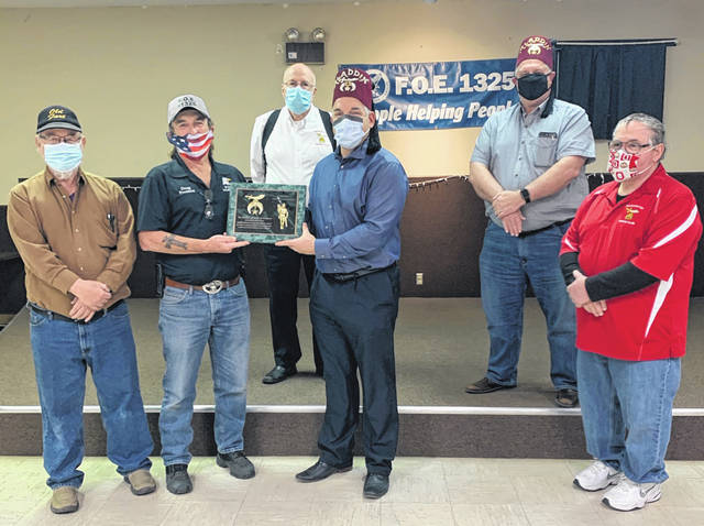 The Greenfield Eagles recently donated a check for $5,000 to Shriners Hospital for Children. This check puts their total donation to $10,000 over the last two years. Pictured left to right - Jim Cooper (Eagles), Doug Templin (Eagles), (back) Kenny Arnold (Washington Shrine), Presenting Plaque & receiving check- President Washington Shrine - Mike Callahan, John Heinz (Washington Shrine), Dannie Maxey (Washington Shrine).