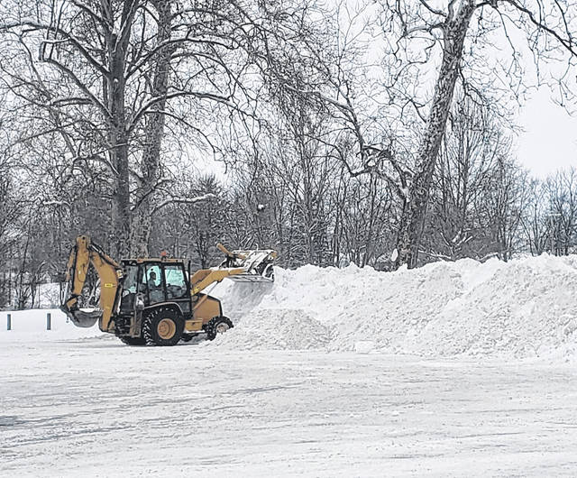 Crews have been placing collected snow from city streets in the parking lot of Washington Park off Eyman Park Drive.