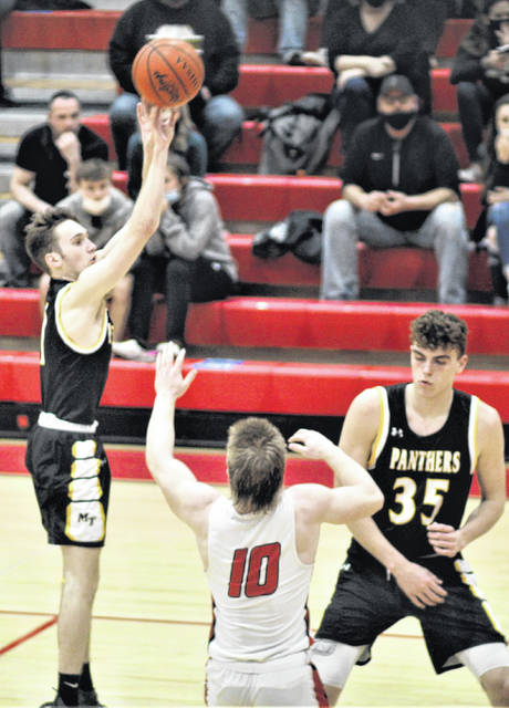 Miami Trace senior Cameron Moore (left) shoots a jumper over Logan Elm's Jason Sailor (10) as Panther senior Logan Rodgers sets a screen during a Division II Sectional semifinal game at Logan Elm High School Thursday, Feb. 25, 2021.