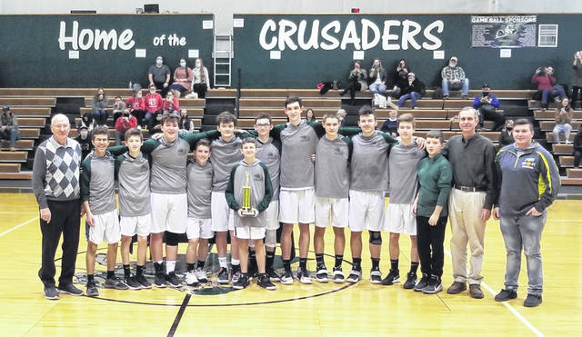 The Crusaders on the court at Fayette Christian School following their victory in the fourth annual FCS/Epifano's McDonald's Basketball Invitational Saturday, Jan. 23, 2021. (l-r); Coach Gary Shaffer, Toby Butcher, Jake Crichton, Cade Whitaker, Gage McDaniel, Aaron Taylor, Zander Ivey, (Luke Granger, holding trophy), Drew Pontious, Brady Bumpus, Nate Crichton, Micah Coole, Coach Vic Pontious and Noah Gibbs.