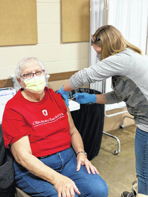 Hannah Morris was a nurse at Fayette County Public Health for 35 years. On Tuesday she received her second dose of the COVID-19 vaccine from FCPH nurse Emily Bower, RN, BSN.