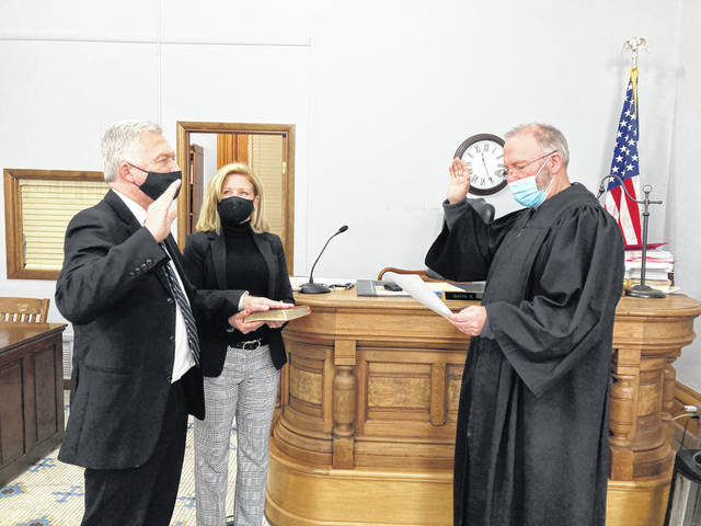 On Jan. 26, Judge David B. Bender was sworn in by Judge Steven P. Beathard for another term as Fayette County Probate/Juvenile Judge. Susan Bender held the Bible for her husband as he took the oath of office.