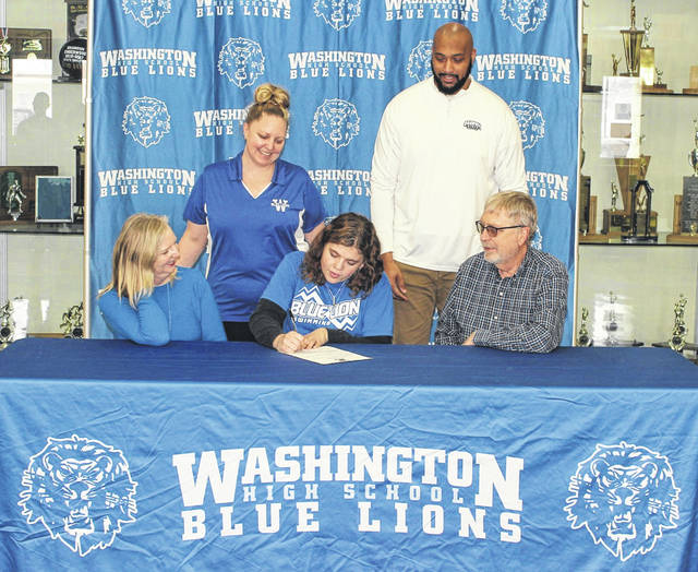 Washington High School senior Julianne Kasberg on Feb. 10, 2021 signed a letter of intent to attend Shawnee State University where she will continue her education and athletic career as a member of the Bears' swim team. Joining Kasberg (seated in the middle) are her mother, Katie Kasberg (standing), and her new coach from Shawnee State, Gerald Cadogan (standing), as well as her grandparents, Kay Kasberg and Joe Kasberg (seated).