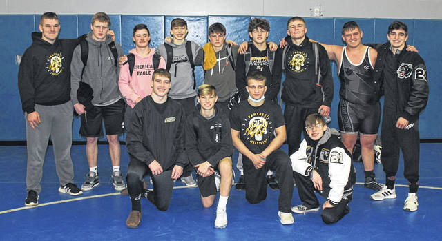 Members of the Miami Trace Panthers wrestling team are pictured following their win of the Frontier Athletic Conference tournament, held at Washington High School Friday, Feb. 12, 2021. (front, l-r); Graham Carson, Corbin Melvin, Vinnie Munro, Titus Lehr; (back, l-r); Luke Anders, Jayden LeBeau, Aaron Little, Weston Melvin, Riston LeBeau, Asher LeBeau, Kylan Knapp, Luke Hoppes and Mcale Callahan.