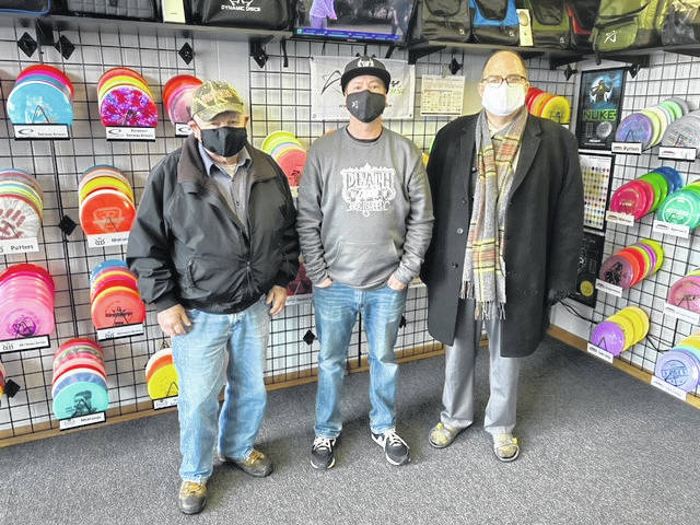 Death Putt Disc Supply, founded in January of 2019, is now located in our historic downtown at 149 S. Fayette St. in Washington Court House. Owner Jason Stritenberger (pictured middle) hopes to expand the development of the sport of disc golf within the community, not only by sales and distribution of supplies, but hopefully by the implementation of a local disc golf course. Products offered are discs, baskets, bags, apparel, and accessories, for both novice and expert players. For more information about disc golf, stop by their new location, or check them out online at www.deathputtdiscsupply.com Also pictured: councilman, Jim Chrisman, and city manager, Joe Denen