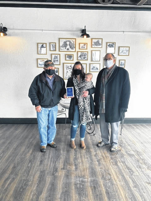 The City of Washington Court House recently presented a New Business Plaque to Pawfections Pet Salon, a full service grooming salon offering bathing, hair blowouts, nail trims, ear cleaning, teeth brushing and haircuts. Owner and groomer, April Penwell, (pictured middle with daughter, Ava) has over 15 years' experience with animals ranging from horses to dogs. Pawfections is located at 153 S. Fayette St. in downtown Washington Court House, and hopes to be open within the month. Also pictured; councilman Jim Chrisman and city manager Joe Denen