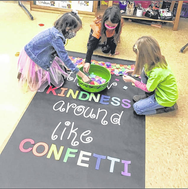 """Miami Trace Elementary School participated in """"The Great Kindness Challenge"""" recently as a way to encourage kindness and love among students and staff. Pictured (L to R) are several students working on a poster to help spread kindness: Livia Patterson, Emma Thoroman and Kenzie Miller."""
