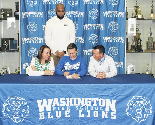 Washington High School senior Ty Rose on Feb. 10, 2021 signed a letter of intent to attend Shawnee State University, where he will continue his education and his athletic career as a member of the Bears' swim team. He was joined for the occasion by his mom and dad, Tami and Tracy Rose and by Shawnee State swim coach Gerald Cadogan.
