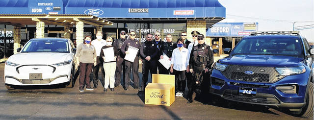 Beford Ford in Washington Court House recently partnered with Ford Motor Company to help distribute masks to the community. Pictured are officers with the Washington Police Department receiving masks.
