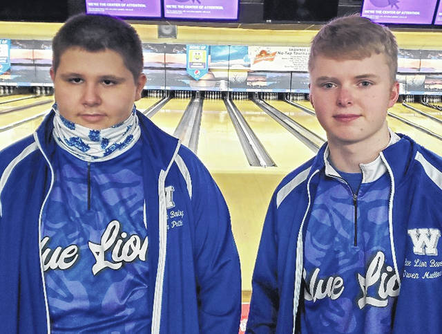 Washington High School sophomore Jordan Pottle, left and senior Owen Mullins, qualified to the State bowling tournament by placing third and fourth, respectively, at the District tournament on Feb. 22, 2021.