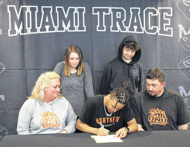 On Thursday, March 18, 2021, Miami Trace High School senior Caleb Brannigan signed a letter of intent to attend Ohio Northern University, where he will continue his education and his athletic career as a member of the Polar Bears' track and cross country teams. Brannigan, seated, center, is flanked by his parents, Lacey and Josh Miller and joined by his sister, Kylee Miller and his brother, Evan Mollett. Caleb has two other siblings, Jaxson Miller and Kennadi Miller (not pictured).