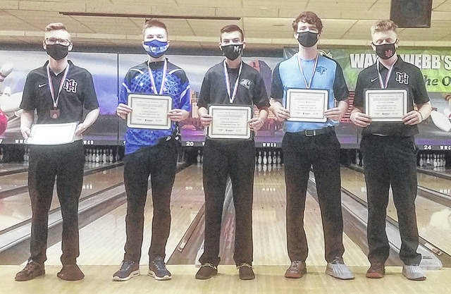 Miami Trace junior Connor Collins, middle, stands in third place after the Division I State bowling tournament at Wayne Webb's Columbus Bowl Saturday, March 6, 2021. He becomes the highest-placing bowler from Fayette County since the program began.