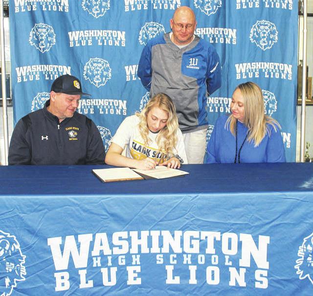 Washington High School senior Corynn Chrisman (seated, middle) on March 5, 2021 signs a letter of intent to attend Clark State College, where she will continue her education and her athletic career as a member of the Eagles softball team. She was joined for the occasion by Clark State head softball coach, Chris Wamsley, left, her mother, Minda Chrisman and standing, Washington head softball coach, Rick Foose.