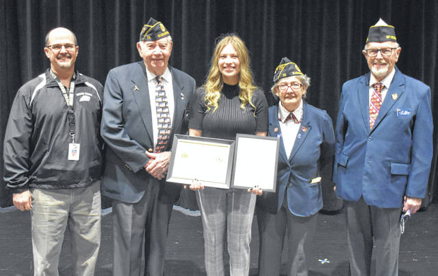 Siara Eggleton was one of two young women from Miami Trace High School who were honored for their exceptional success on the American Legion Americanism and Government test. Eggleton not only claimed victory at the school and county levels with her score, but she went on to win at both the district and state levels. She will now have the opportunity to travel to Washington D.C., Gettysburg and other historic and politically prominent places on an all-expense paid trip with other winners like herself. Eggleton (at center) is pictured with Matt Barga, Miami Trace High School guidance counselor, Ed Helt, Americanism chairman for the American Legion Post 25, Patty Deweese, American Legion Post 25 County Commander, and Paul Sands, the first American Legion Vice-Commander for the Seventh District.