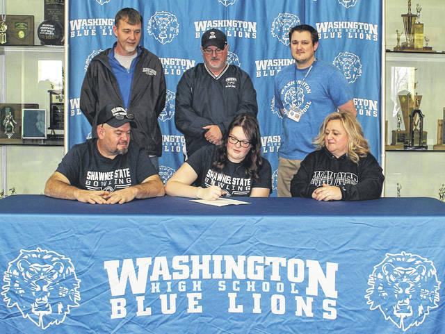 On Friday, March 26, 2021, Washington High School senior Hanna Yoho signed a letter of intent to attend Shawnee State University, where she will continue her education and her athletic career as a member of the women's bowling team. She is joined for the occasion by her father, Mike Yoho, her step-mother, Melissa Puckett and, in back, (l-r); Blue Lion boys' bowling coach Buckie Caulley, Shawnee State bowling coach Bryan Sturgell and Lady Lions bowling coach Anthony Amore.