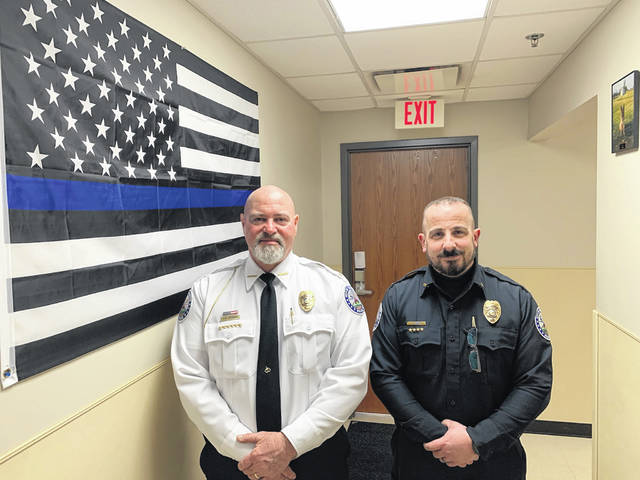 Outgoing chief Brian Hottinger (left) is passing the torch to the newest chief of the Washington Police Department, Jeff Funari.