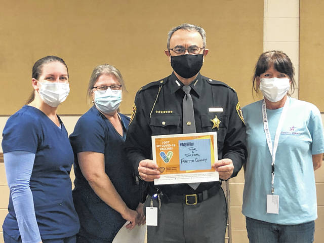 "Fayette County Sheriff Vernon Stanforth recently received his COVID-19 vaccination. He is pictured with nurses Kate Halliday, Becky Allman and Teresa Wisecup. Stanforth wrote that he received the vaccine ""for a safer Fayette County."""