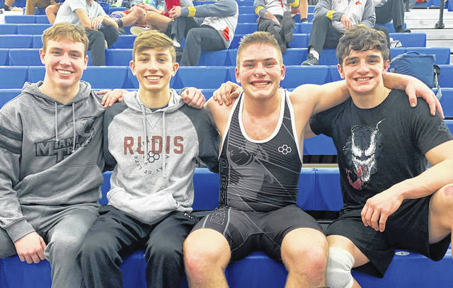 The four members of the Miami Trace wrestling team, above, have qualified to this weekend's State tournament. They accomplished their goal by placing in the top four at the Division II District tournament held at Gallia Academy High School Friday and Saturday, March 5, 6, 2021. (l-r); Graham Carson, Weston Melvin, Bryce Bennett and Mcale Callahan.
