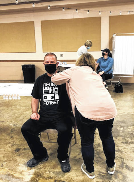 Barry Pettit, pastor at South Side Church of Christ, recently received his first dose of COVID-19 vaccine from Kris Wright, RN.
