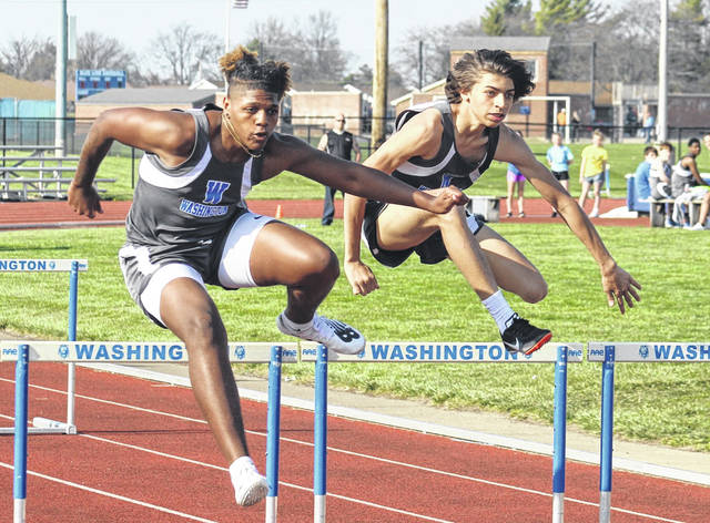 Washington Blue Lions Ethan Rogers-Wright, left, and Paris Nelson clear their respective hurdles in the 110-meter event during a dual meet at Washington High School Tuesday, April 6, 2021. Please see today's sports for a report.