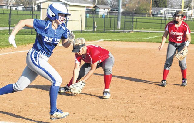 Washington's Brooklyn Devenport runs to first base after putting down a bunt during a non-conference game at home against Westfall Tuesday, April 6, 2021.