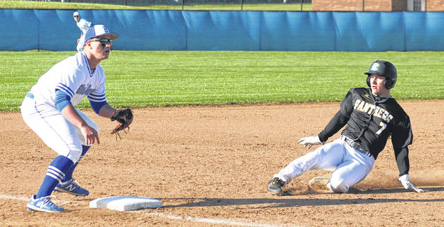 Conner Bucher slides into third base for Miami Trace as Washington's Tyler Tackage awaits the throw during the second meeting of the two Fayette County teams this season.