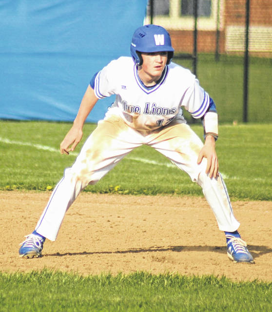 Washington's Evan Lynch takes a lead at first base during a Frontier Athletic Conference game against Hillsboro Friday, April 9, 2021. The game was played at Washington High School.