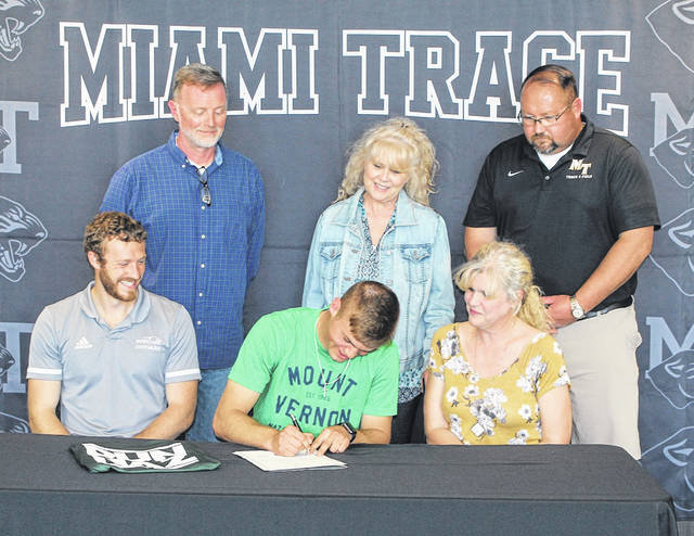 Miami Trace High School senior, Jaden Haldeman, seated, center, signs a letter of intent to attend Mount Vernon Nazarene University, where he will study criminal justice and be a member of the Cougars' track team. He was joined for the occasion on Tuesday, April 27, 2021 by (front, l-r); MVNU track coach Ellis Gallion, his mother, Sarah Haldeman; (back, l-r); Kevin Evans, his aunt, Becky Lucas and Miami Trace head track coach Brent Noes.