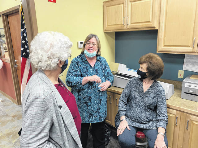 Carrie Ferguson (left), a former employee at the Fayette County Board of Elections office, talks with current Board of Elections members Robin Beekman (center) and Judy Craig (right) at Beth Ann Snyder's retirement open house.