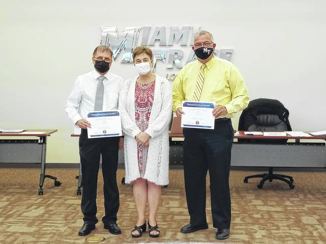 Miami Trace Local Schools Board of Education members Charlie Andrews and David Miller were honored with their 10-and-15-year milestone awards from the Ohio School Boards Association (OSBA) on Monday during the regularly scheduled meeting. Pictured (L to R): Miller, OSBA Central Region Manager Kimberley Miller-Smith and Andrews.