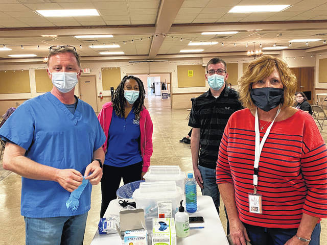 Kevin Evans, Medical Reserves Corps (MRC) volunteer, Scherika Brinson, FCPH, Ethan Johnson, FCPH, and Melissa Garland, MRC volunteer at last week's mass vaccination clinic.