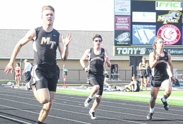Miami Trace's Jaden Haldeman sprints down the track in the 100-meter dash in a tri-meet with Hillsboro and Waynesville Tuesday, April 13, 2021. Haldeman beat a field of 10 other runners to win with a time of 11.67.