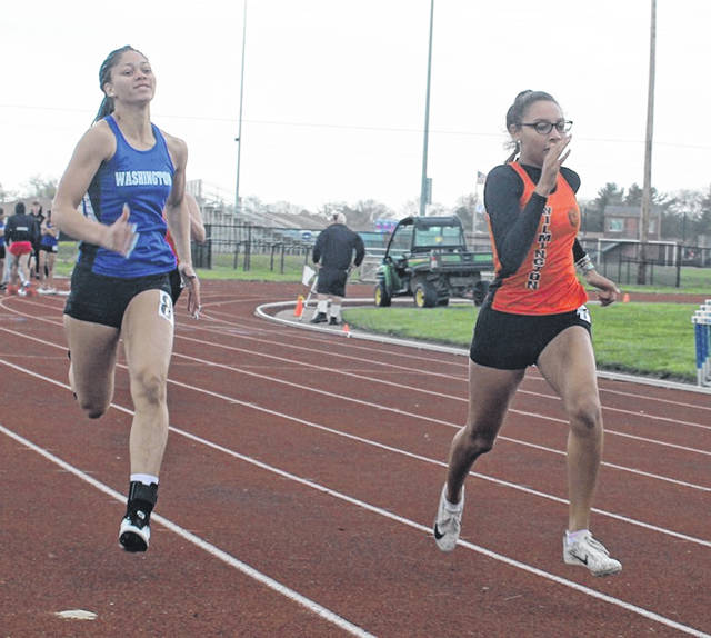 Washington's Jeleeya Tyree-Smith, at left, runs the 100-meter dash during a tri-meet against Wilmington and Fairfield Tuesday, April 20, 2021 at Washington High School.