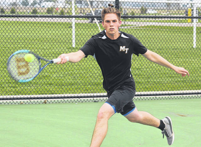 Miami Trace's Jacob Cline returns a shot at first singles during a match against Logan Elm Wednesday, April 28, 2021 at Miami Trace High School.