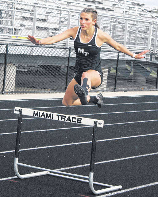 Miami Trace's Jana Griffith clears a hurdle in the 300-meter race Tuesday, April 20, 2021 at Miami Trace High School. Griffith placed first in the event.