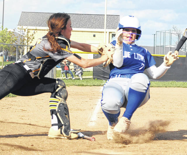 Miami Trace catcher Paighten Reed, left, tags Washington's Addison Knisley out on a close play at home during a Frontier Athletic Conference game at Miami Trace High School Friday, April 16, 2021.