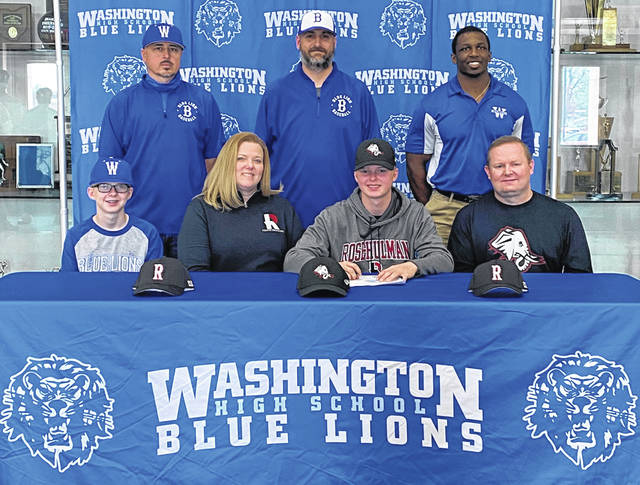 Washington High School senior Owen Mullins, seated, third from left, signs a letter of intent on April 7, 2021 to attend Rose-Hulman Institute of Technology, where he will study mechanical engineering and be a member of the Fightin' Engineers baseball team. He is joined by his family, seated (l-r); brother Mason, his parents, Becky and Darren and, standing (l-r); Washington Blue Lion assistant baseball coach Brandon Runk, head coach Mark Schwartz and Marlin Ellis, strength and conditioning coach.